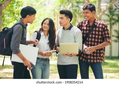 Group of Diversity Student working on laptop and smart phone together at university, Happy multi ethnic friend successfully completes the thesis report and passed the final exam in asian college.