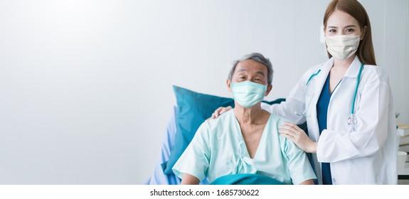 Gruppe von Ärzten und Krankenschwestern, die eine Schutzmaske bei der Überprüfung und Übernahme von Infektionen mit Covid-19-Infektionen tragen