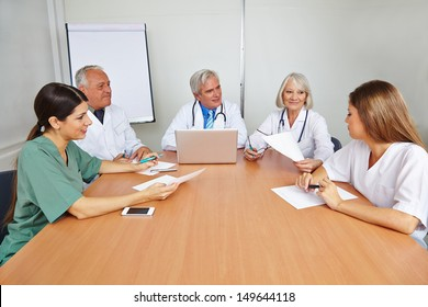 Group of doctors with applicant at job interview for a hospital