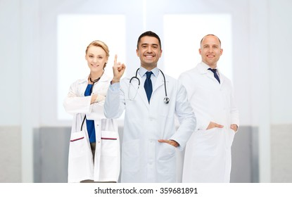 group of doctors at hospital pointing finger up