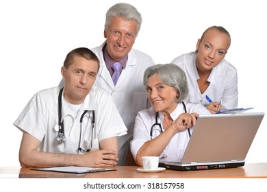 Group of doctors with laptop at the table