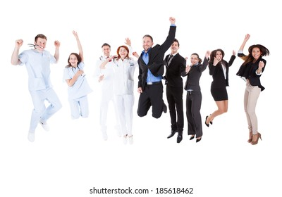 Group of doctors and managers jumping. Isolated on white
