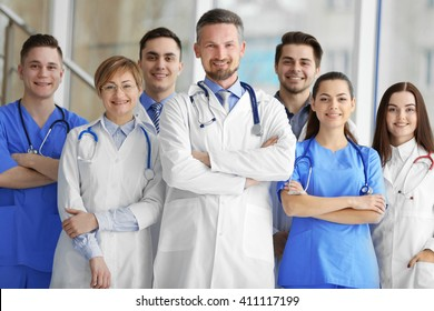A group of doctors and nurses standing in the hospital