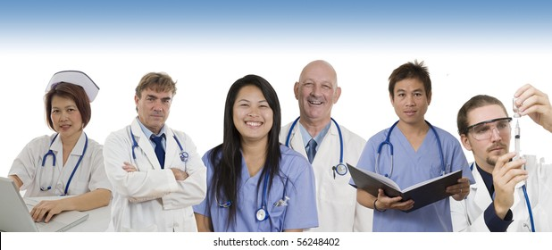 Group of Doctors and Nurses standing with white background to be used as banner
