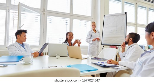 Group of doctors in a seminar during a training course with a speaker