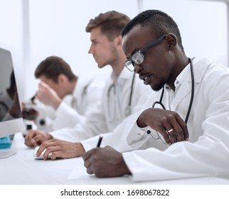 group of doctors sitting in the laboratory