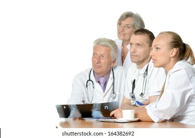 A group of doctors sitting in office