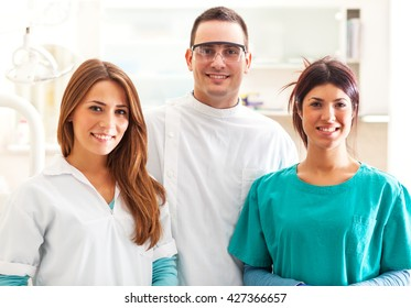 Group of  doctors standing in their office and looking at camera.