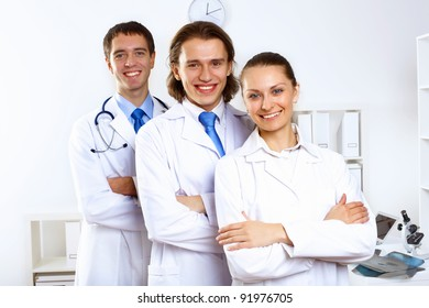 Group of doctors in uniforms together in clinic