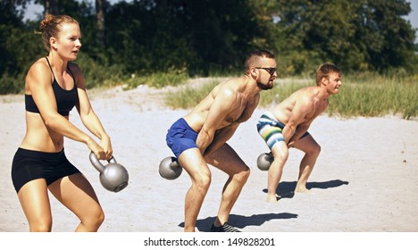 Group doing workout on beach on a hot summer day