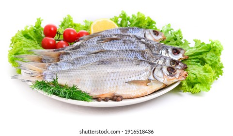 Group of dried fish at plate . Seafood