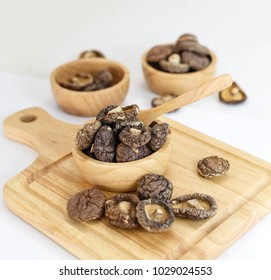 Group of dry shiitake mushrooms isolated on white background