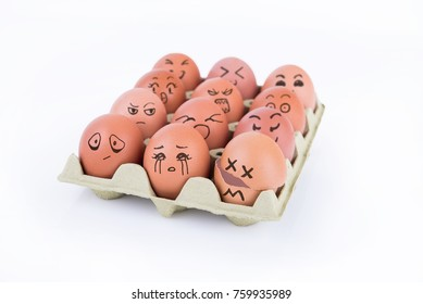 Group of eggs where one is broken and the others looking