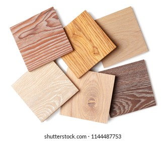 group of eight small samples of wooden parquet from different types of wood, different colors and textures for the designer's work. isolated on white background