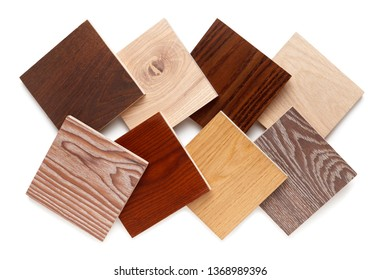 group of eight small samples of wooden parquet from different types of wood, different colors and textures for the designer's work. isolated on white background. Flat lay, top view