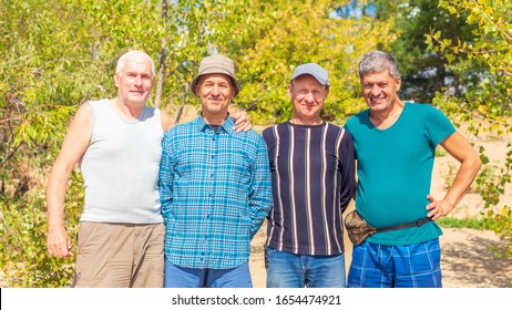 A group of elderly cheerful tourists have a great rest in nature.