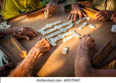A group of elderly farmers playing dominoes in the country around Vinales, Cuba