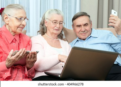 Group of elderly people. Group of older people having fun in communicating with the family on the internet in the comfortable living room