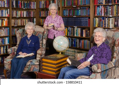 A group of elderly women in an assisted living's residence library
