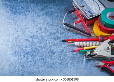 Group of electrical equipment on metallic background horizontal view.