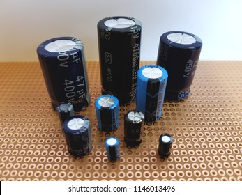group of electrolytic capacitors different sizes
