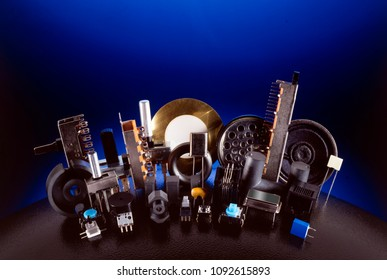 group of electronic component on black sphere over dark blue background
