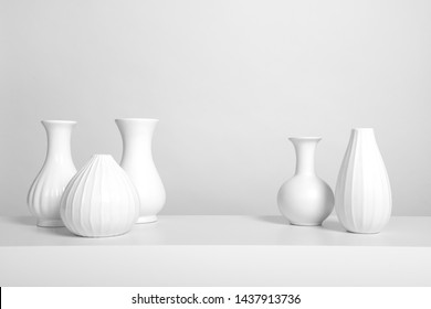 Group of elegant white vases in a white interior