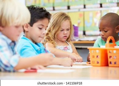 Group Of Elementary Age Children In Art Class
