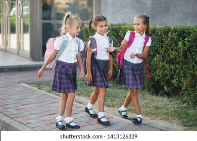 Group of elementary school kids running at school