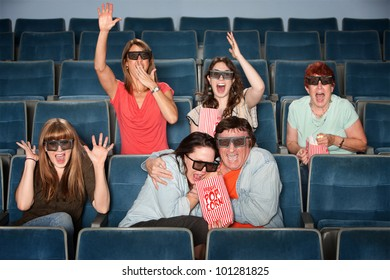 Group of emotional people with 3D glasses in a theater