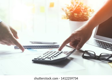 Group of employees co-operate on a budget. Finance concept in office.
