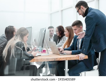 group of employees work in a modern office
