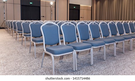 Group of empty blue chairs in modern conference hall - presentation room for seminars