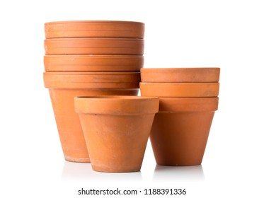 Group of empty, stacked, used terracotta planting pots over white background