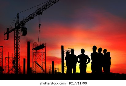 Group of  engineer on working site , engineer and tower cranes at construction site and city background