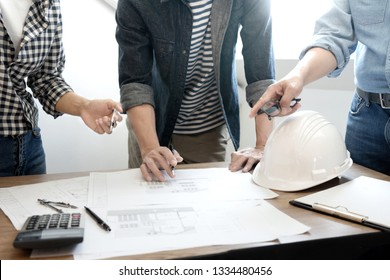 Group of engineering or architect discussing and working on blueprint with architect equipment, Construction engineer or architectural project  concept.