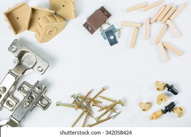 Group of equipment for wooden furniture assembly on white wooden board with space for text.