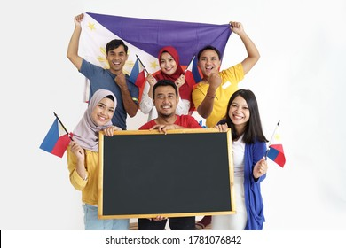 group of excited asian filipino supporter holding philippines flag and blank blackboard