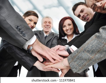 Group of executives placing their hands together