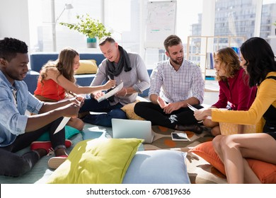 Group of executives working together in office