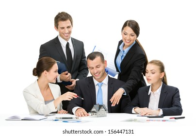 Group of executives working while sitting at the table, isolated. Concept of teamwork and cooperation