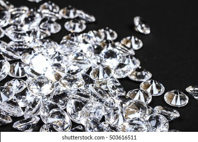 Group of fake diamonds on a black background