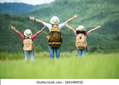 Group family children travel nature trips raise arms and standing see mountain outdoors, adventure and tourism for destination leisure trips for education and relax in nature park. Travel vacations  - Shutterstock ID 1841480920