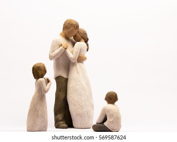 Group of family Figurines, mum and dad dancing and the children looking on