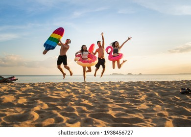 Group of family and friends  jumping on the beach. lifestyle people vacation holiday on beach.