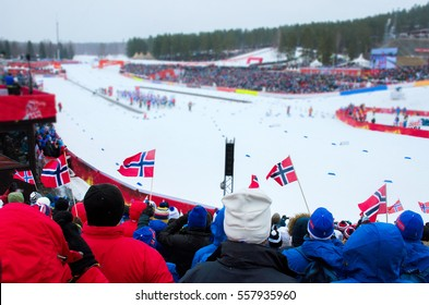 Group of fans from norway and sweden watching at professional competition in nordic ski - world cup in north of Europe - Concept image for winter olympic games 2018 in Pyeongchang - South Korea