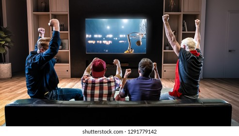A group of fans is watching a basketball moment on the TV and celebrating a victory, sitting on the couch in the living room. The living room is made in 3D.
