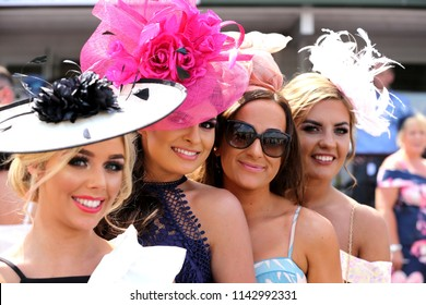 A group of fashionable well dressed women pose whilst enjoying the social atmosphere at Market Rasen Races Ladies Day : Market Rasen Racecourse, Lincolnshire, UK : 21 July 2018 : Pic Mick Atkins