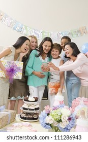 Group of female friends making self-portrait in baby shower party