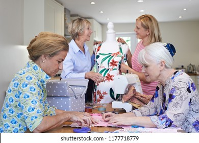 Group Of Female Friends Meeting At Home For Sewing Club